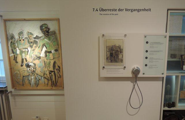 """Ein Polizist als Henker: Ölgemälde """"Babij Jar im September 1941"""" von Anatol Herzfeld in der Villa ten Hompel. Foto: Stadt Münster/Villa ten Hompel"""